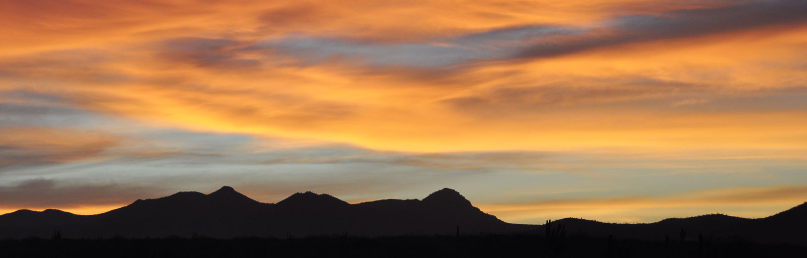 Hiking & Yoga Retreat in Mexico: Sunset and Mountain Silhouette
