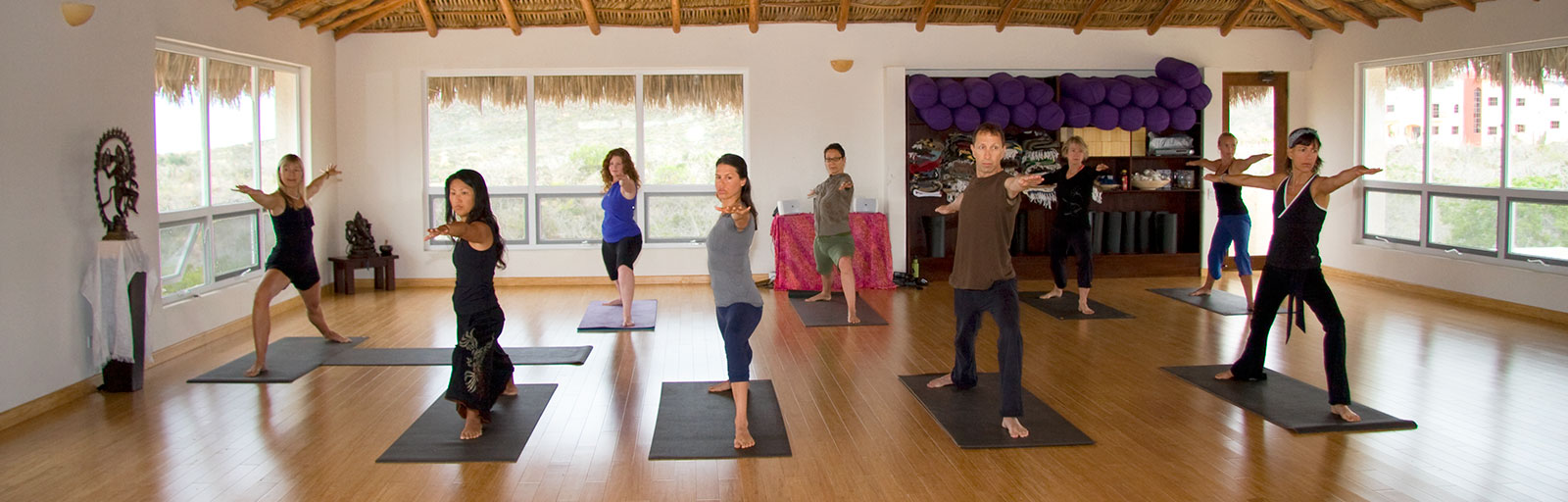 Mexico Yoga Retreats: Warrior Pose in Yoga Class