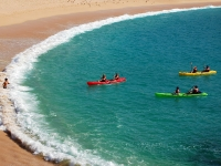 Sea Kayaking Paddling toward Beach - Yoga Retreat - Mexico